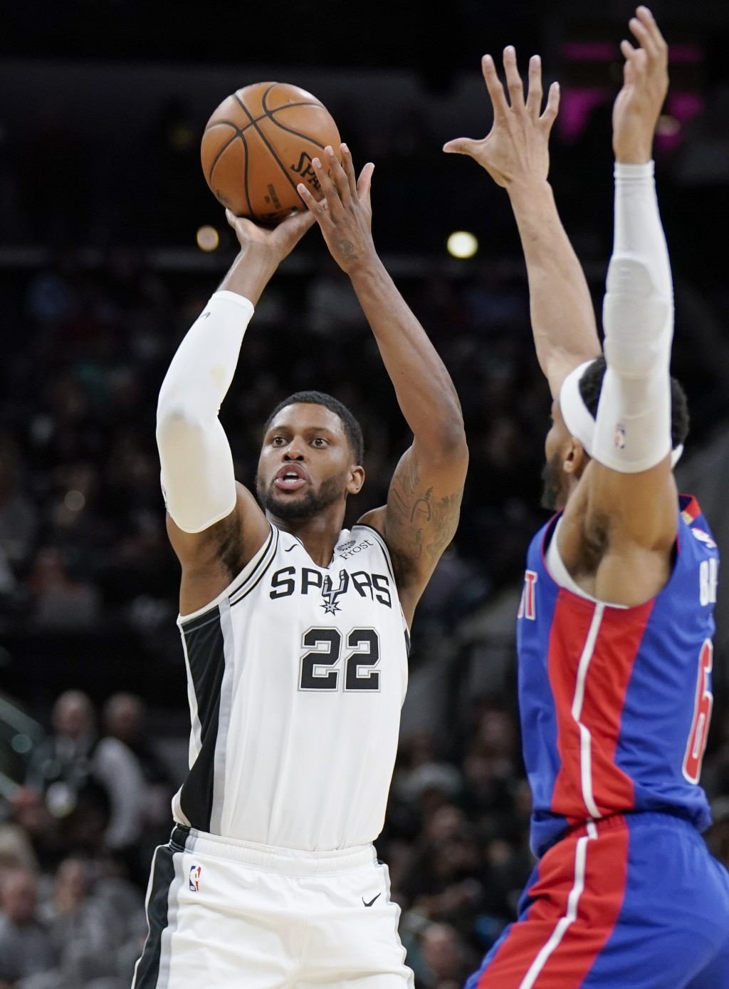 San Antonio Spurs' Rudy Gay (22) shoots next to Detroit Pistons' Bruce Brown during the second half of an NBA basketball game Saturday, Dec. 28, 2019,...