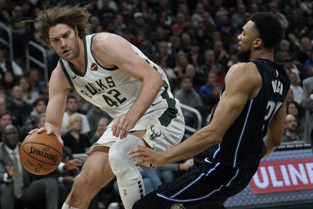 Milwaukee Bucks' Robin Lopez tries to get past Orlando Magic's Khem Birch during the second half of an NBA basketball game Saturday, Dec. 28, 2019, in...