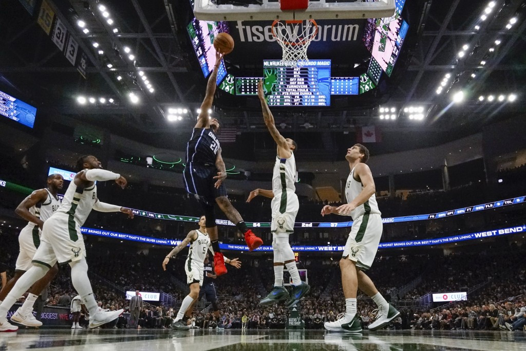 Orlando Magic's Markelle Fultz shoots during the first half of an NBA basketball game against the Milwaukee Bucks Saturday, Dec. 28, 2019, in Milwauke...