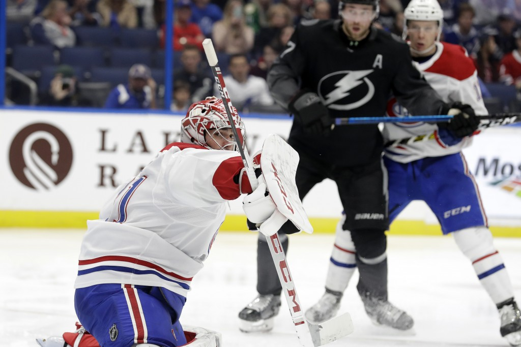 Montreal Canadiens goaltender Carey Price makes a save on a shot by the Tampa Bay Lightning during the second period of an NHL hockey game Saturday, D...