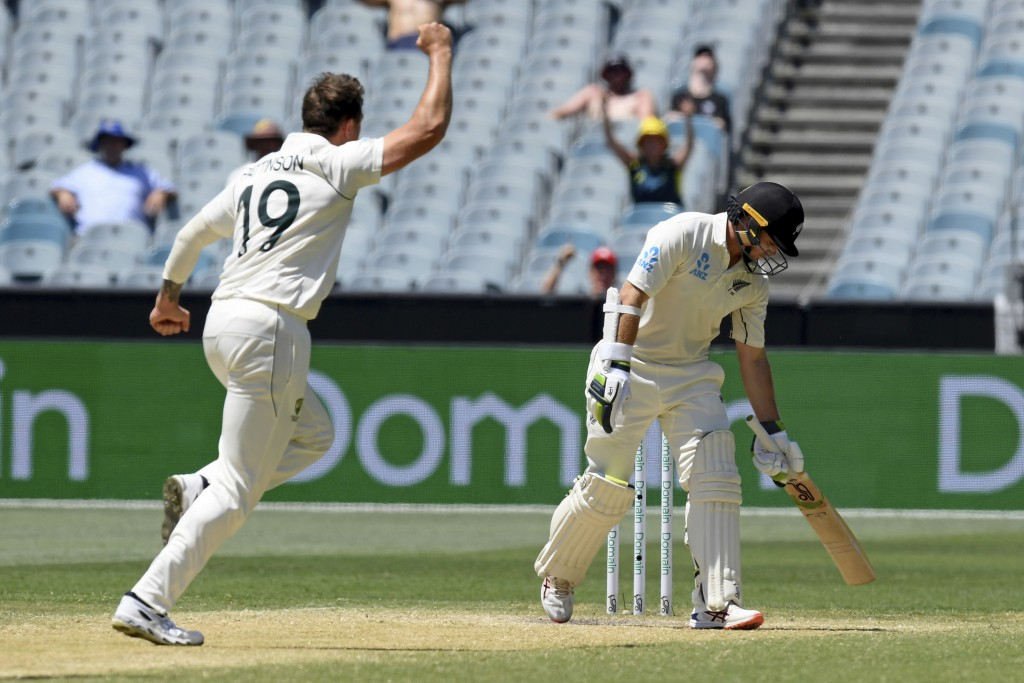 Australia's James Pattinson, left, celebrates the wicket of New Zealand's Tom Latham, right, during their cricket test match in Melbourne, Australia, ...