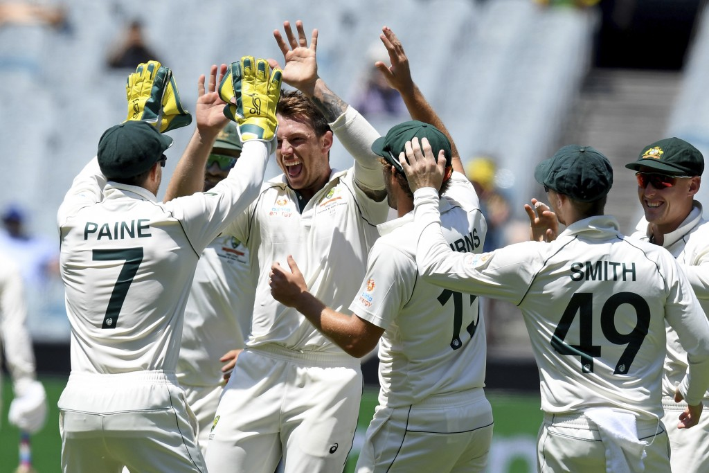 Australia's James Pattinson, second from left, celebrates with teammates after capturing the wicket of New Zealand's Ross Taylor during their cricket ...