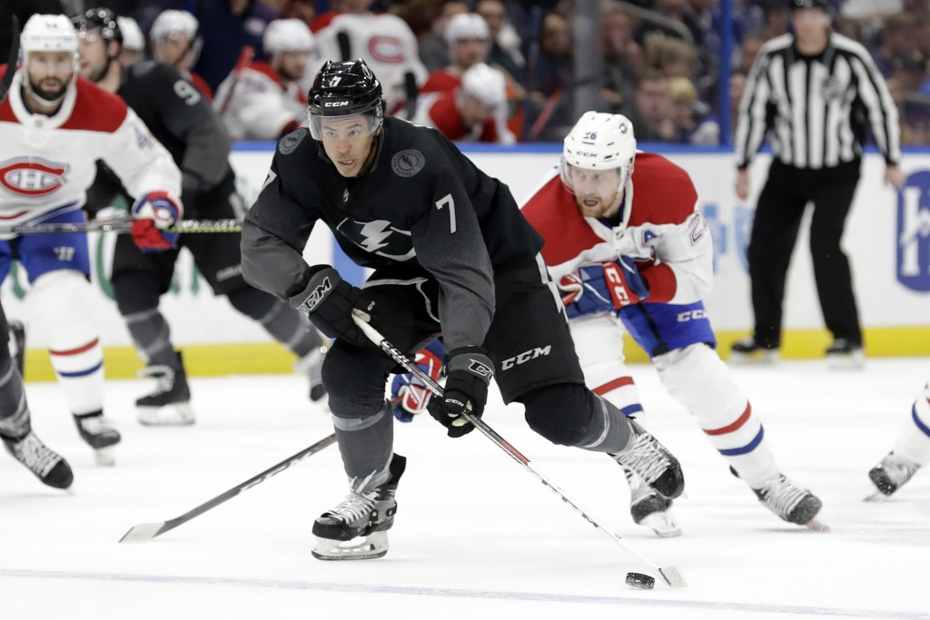 Tampa Bay Lightning right wing Mathieu Joseph (7) breaks free from Montreal Canadiens defenseman Jeff Petry (26) during the second period of an NHL ho...