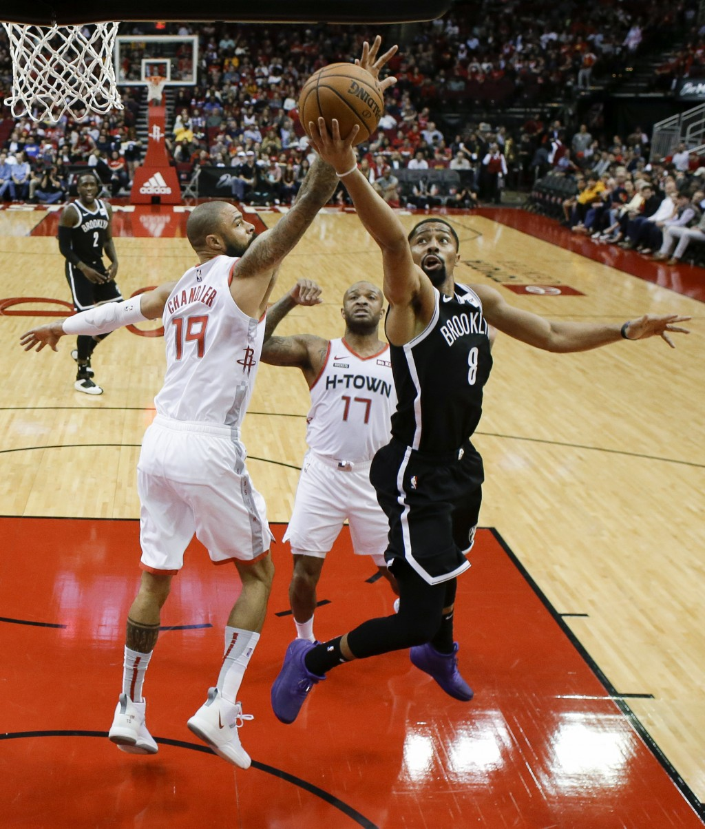 Brooklyn Nets guard Spencer Dinwiddie (8) drives to the basket as Houston Rockets center Tyson Chandler (19) defends during the first half of an NBA b...