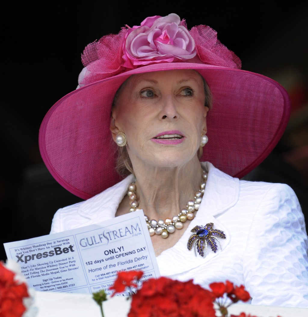 FILE- In this Aug. 7, 2010, file photo, Marylou Whitney watches horse racing from her box seats at Saratoga Race Course in Saratoga Springs, N.Y. Phil...