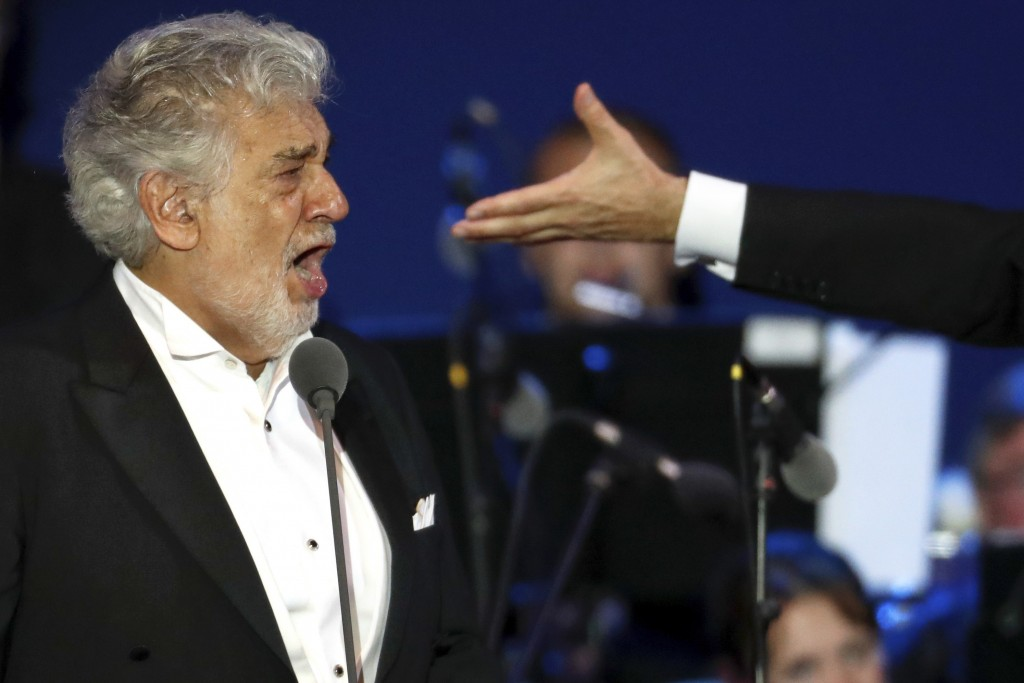 FILE - In this Wednesday, Aug. 28, 2019 file photo, opera star Placido Domingo performs during a concert in Szeged, Hungary. Domingo continued his cal...