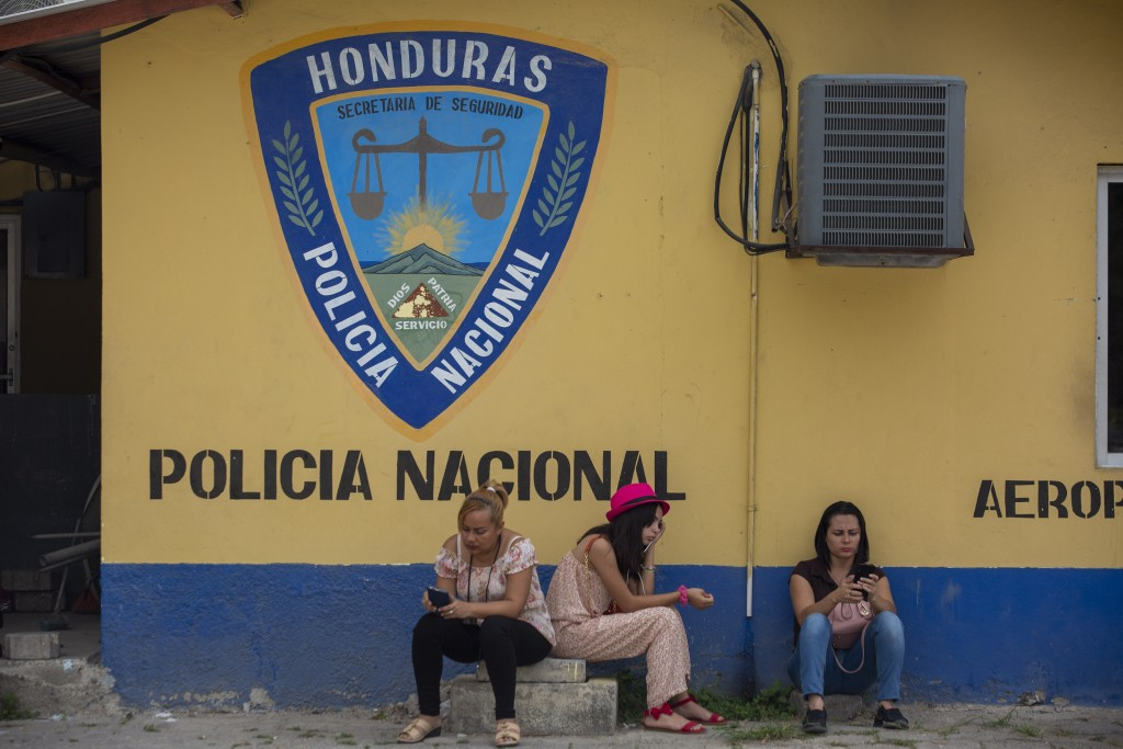 Family members wait outside the Ramon Villeda International Airport in La Lima, Honduras on Nov. 29, 2019, for the arrival of their relatives who were...