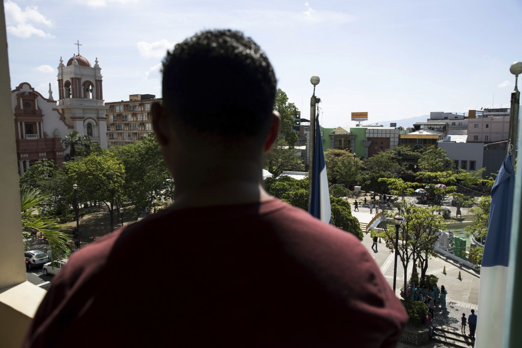 A Honduran man deported from the United States looks over the central park of San Pedro Sula, Honduras on Dec. 1, 2019. As he was walking in the area ...