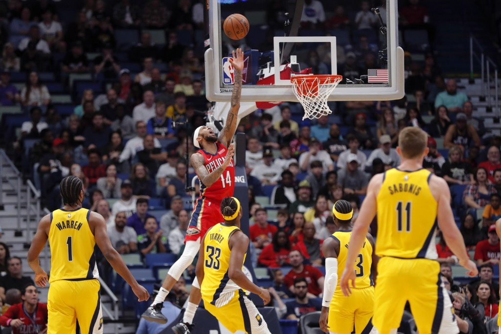 New Orleans Pelicans forward Brandon Ingram (14) goes to the basket during the first half of the team's NBA basketball game against the Indiana Pacers...