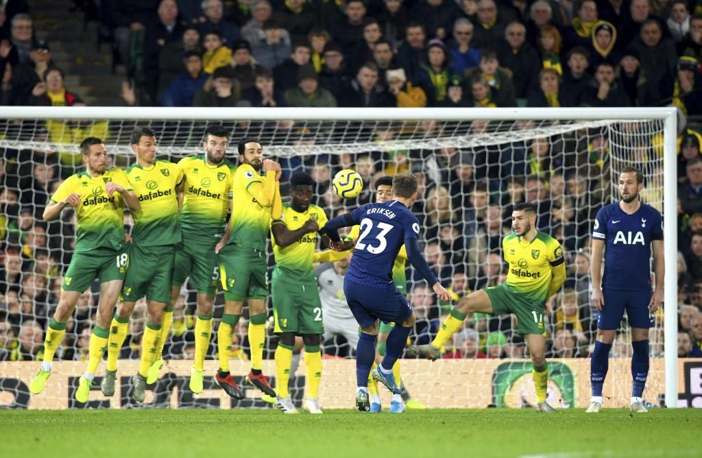 Tottenham Hotspur's Christian Eriksen, center, scores against Norwich City during the English Premier League soccer match at Carrow Road, Norwich, Eng...