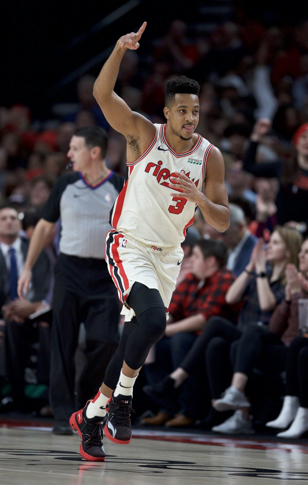 Portland Trail Blazers guard CJ McCollum reacts after making a three-point basket against the Los Angeles Lakers during the first half of an NBA baske...