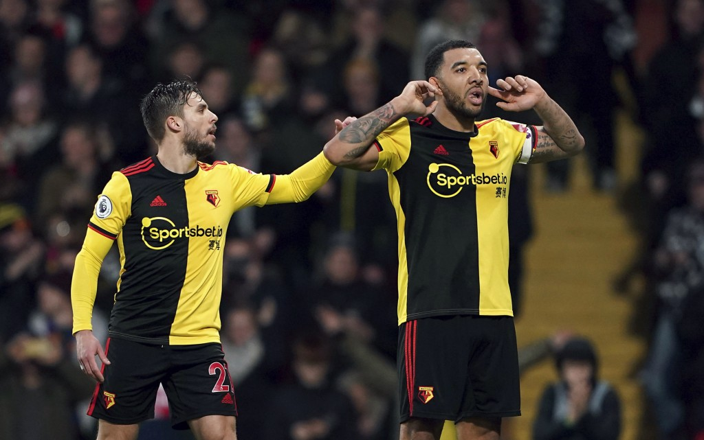 Watford's Troy Deeney, right, celebrates with Kiko Femenia after scoring against Aston Villa during the English Premier League soccer match at Vicarag...
