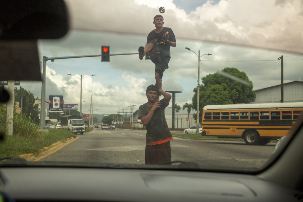Two street jugglers perform on a corner for money in San Pedro Sula, Honduras on Nov. 28, 2019. The city's criminal life is dominated by two street ga...