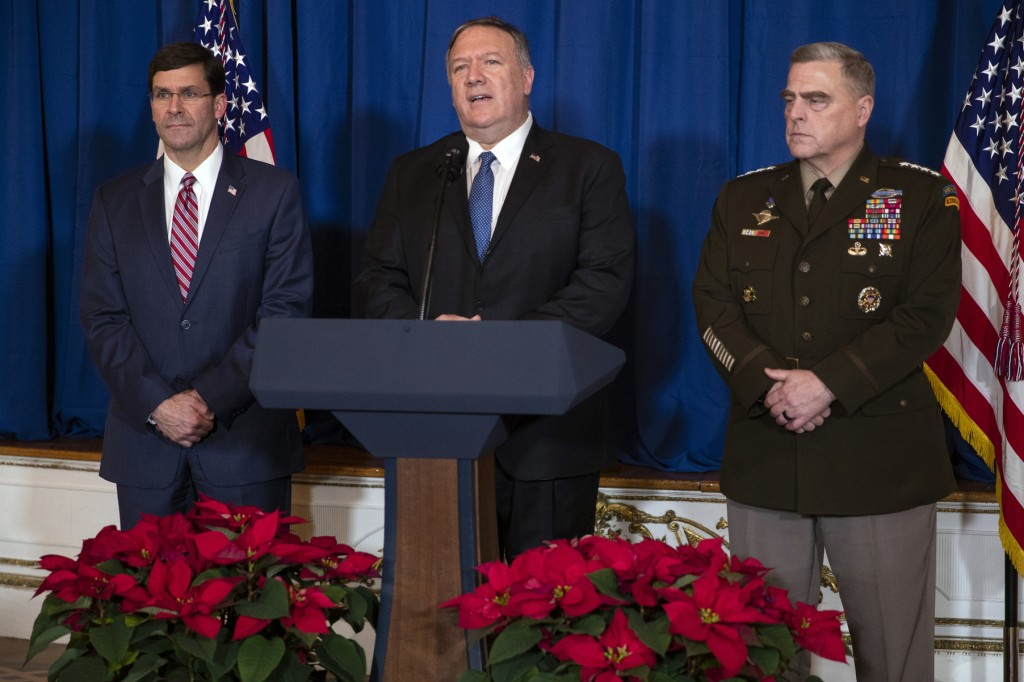 Secretary of Defense Mark Esper, left, and Chairman of the Joint Chiefs of Staff Gen. Mark Milley, right, listen as Secretary of State Mike Pompeo del...
