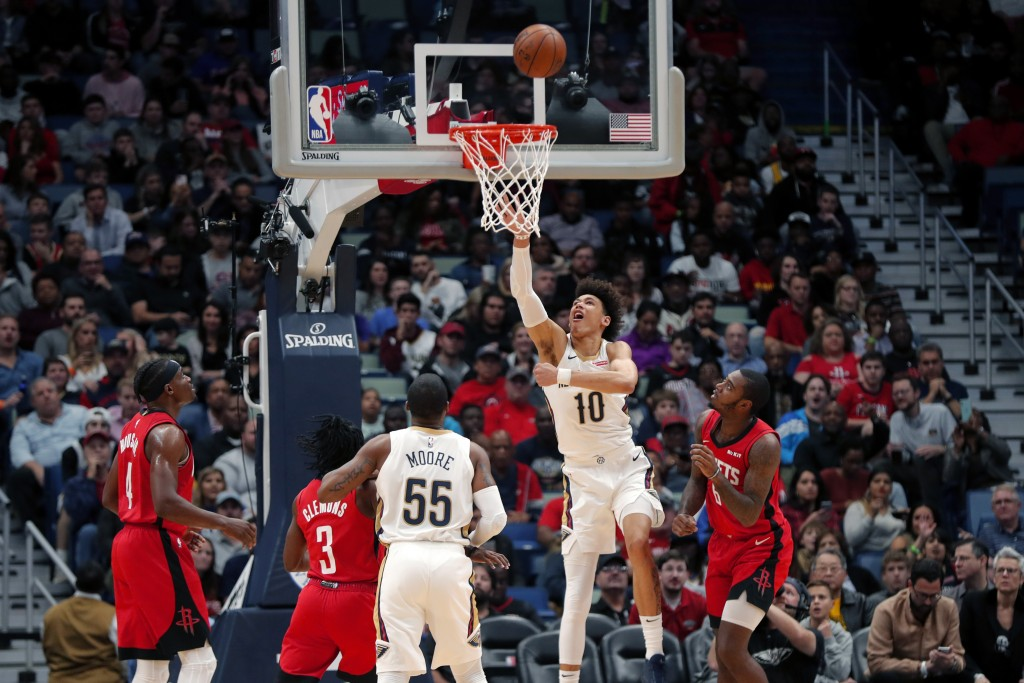 New Orleans Pelicans center Jaxson Hayes (10) goes to the basket between Houston Rockets forward Gary Clark (6), guard Chris Clemons (3) and forward D...