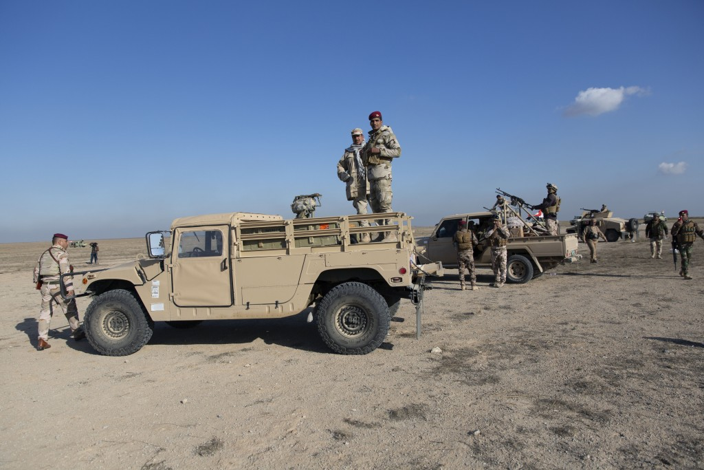 Iraqi army units are deployed during military operations of the Iraqi Army's Seventh Brigade in Anbar, Iraq, Sunday, Dec. 29, 2019. An Iraqi general s...