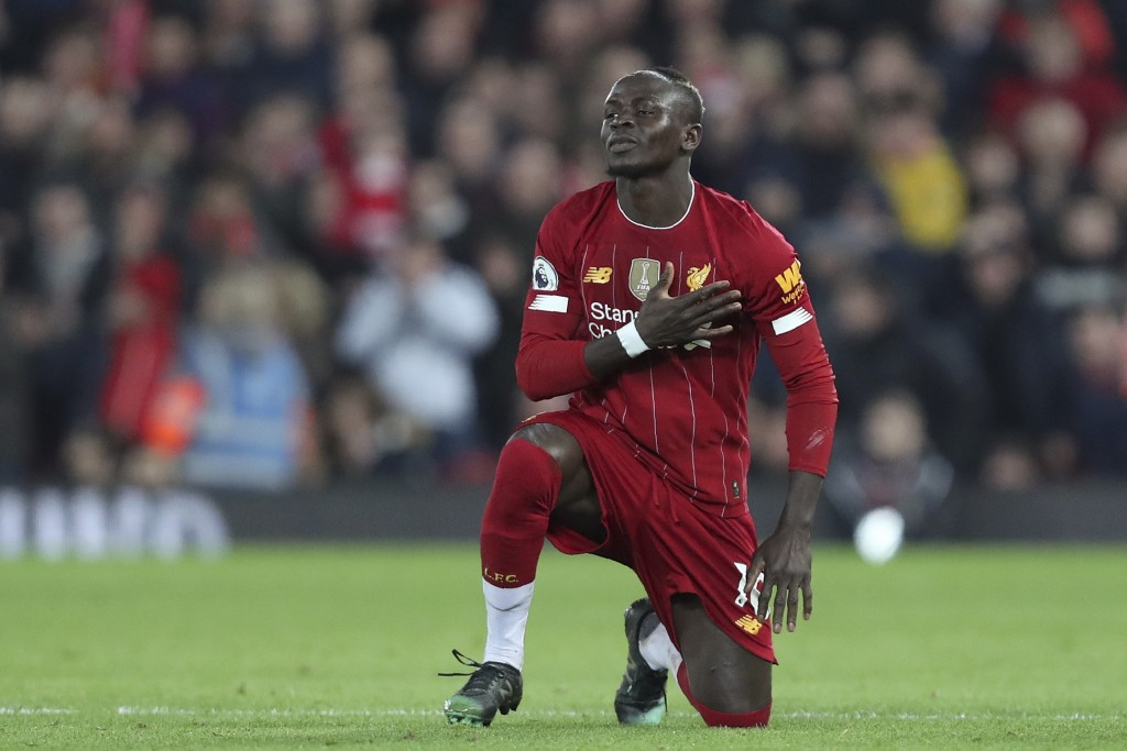 Liverpool's Sadio Mane celebrates after scoring the opening goal during the English Premier League soccer match between Liverpool and Wolverhampton Wa...
