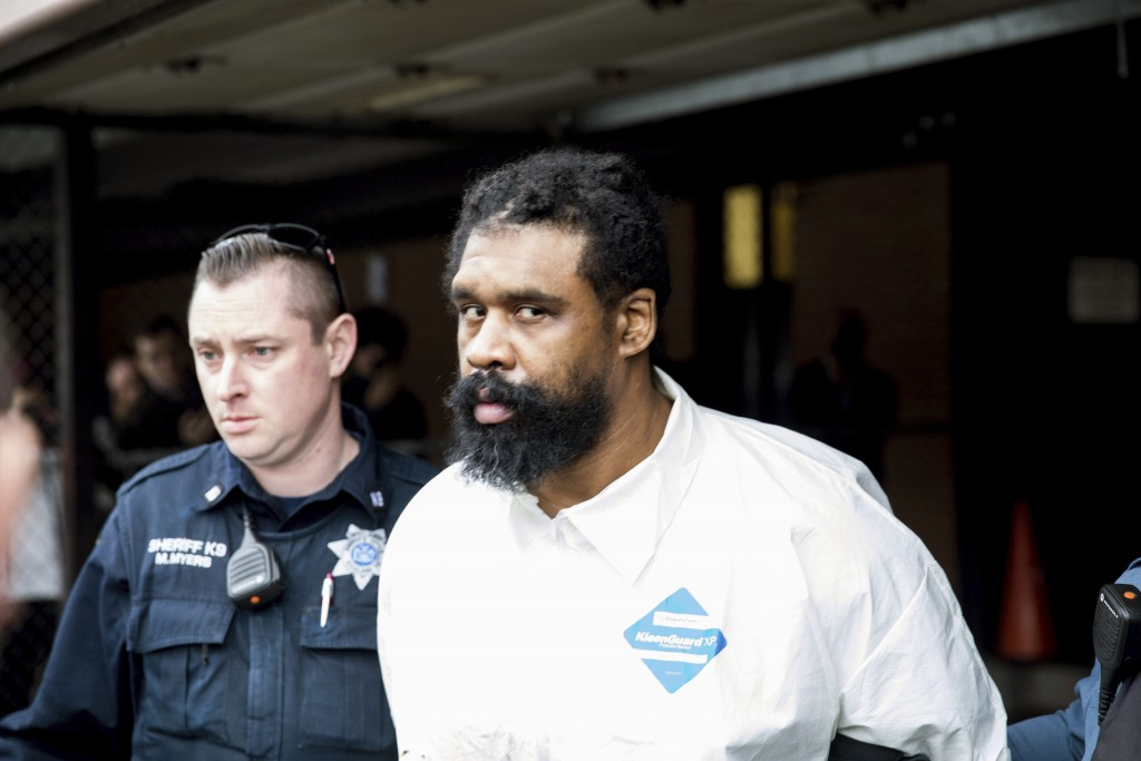 Ramapo police officers escort Grafton Thomas from Ramapo Town Hall to a police vehicle, Sunday, Dec. 29, 2019, in Ramapo, N.Y. Thomas is accused of st...