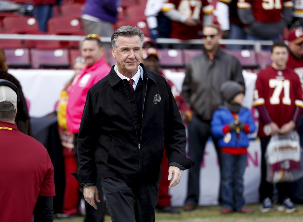 FILE - In this Oct. 21, 2018 file photo, Washington Redskins President Bruce Allen walks across the field before an NFL football game against the Dall...