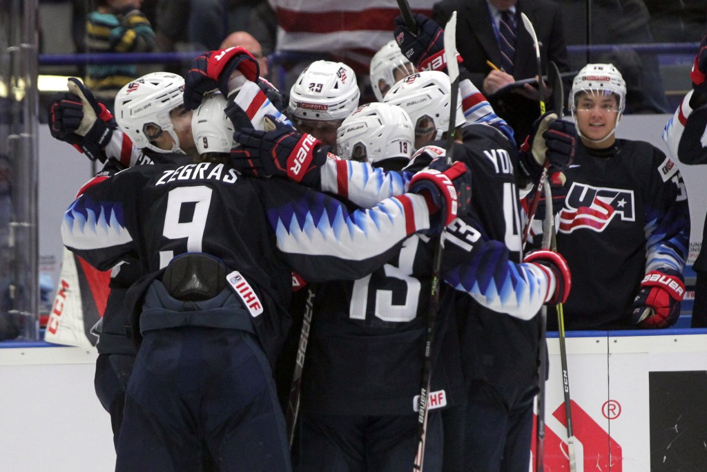 USA players celebrate their first goal during the 2020 IIHF World Junior Ice Hockey Championships Group B match between USA and Russia in Ostrava, Cze...