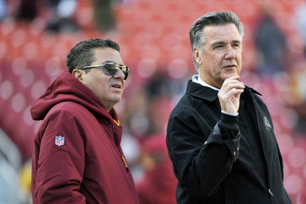 FILE - In this Oct. 21, 2018 file photo, Washington Redskins owner Dan Snyder, left, and team president Bruce Allen talk on the field prior to an NFL ...