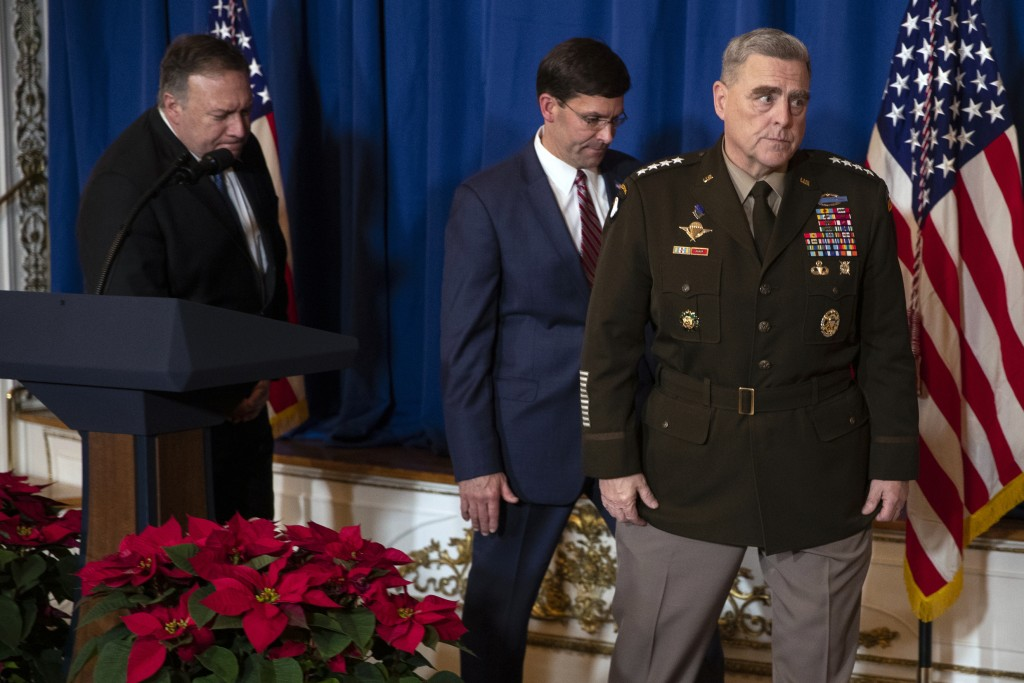 Secretary of State Mike Pompeo, left, Secretary of Defense Mark Esper, center, and Chairman of the Joint Chiefs of Staff Gen. Mark Milley leave the po...