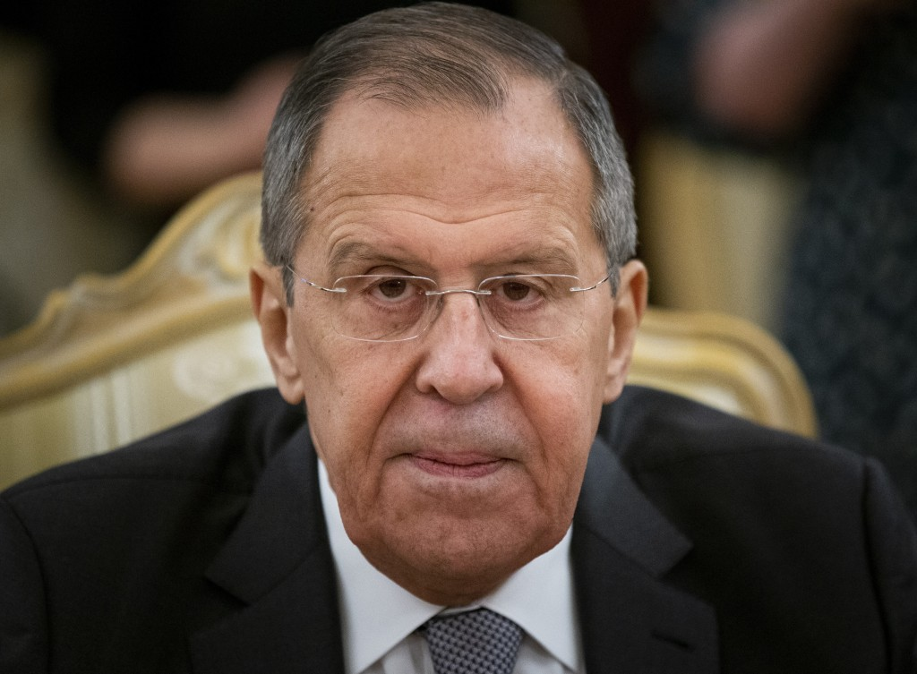 Russian Foreign Minister Sergey Lavrov listens to Iranian Foreign Minister Mohammad Javad Zarif during their talks in Moscow, Russia, Monday, Dec. 30,...