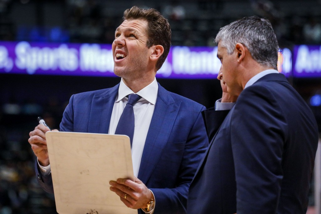 Sacramento Kings coach Luke Walton, left, looks at the scoreboard during a timeout in the first half of an NBA basketball game against the Denver Nugg...