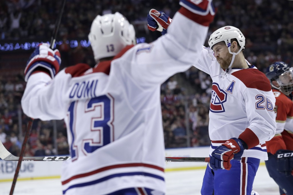 Montreal Canadiens defenseman Jeff Petry (26) reacts after scoring a goal during the second period of an NHL hockey game against the Florida Panthers,...