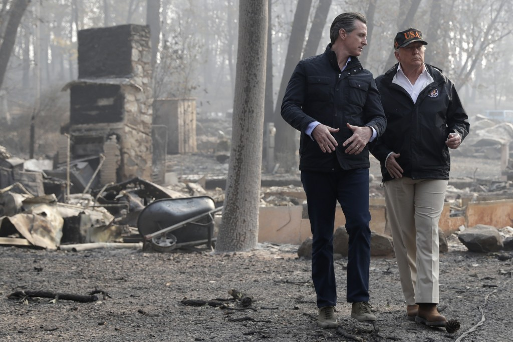 FILE - In this Nov. 17, 2018, file photo, President Donald Trump talks with then California Gov.-elect Gavin Newsom during a visit to a neighborhood d...