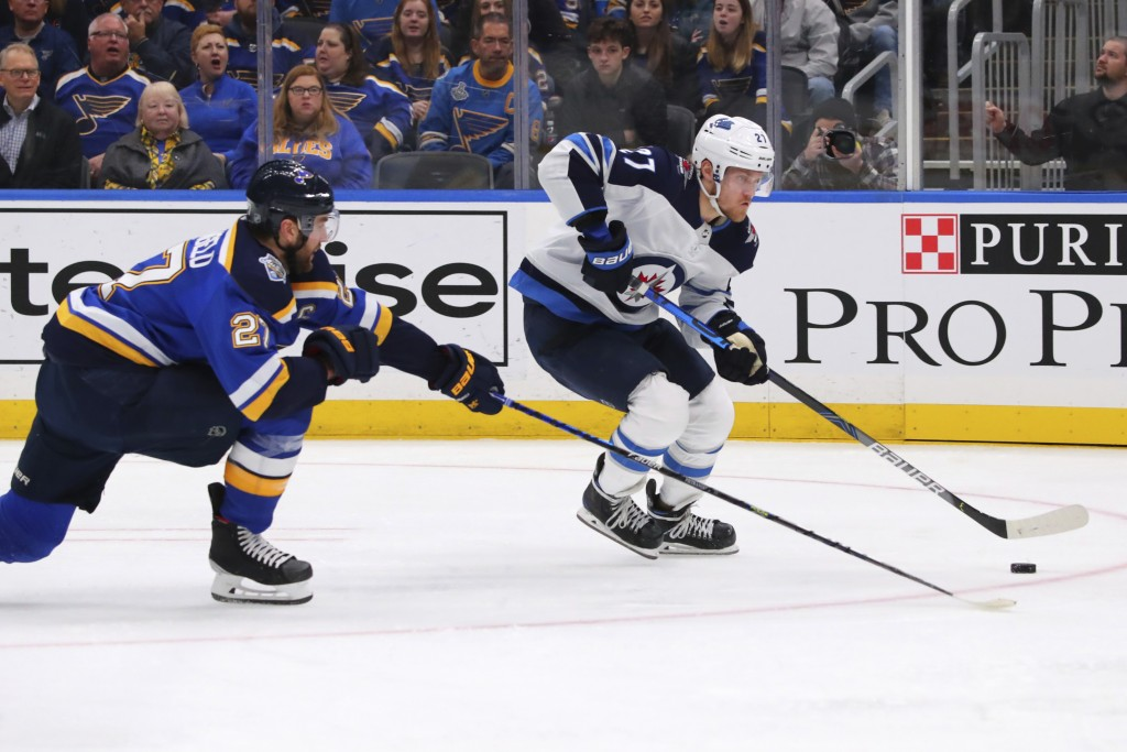 Winnipeg Jets winger Nikolaj Ehlers (27), of Denmark, controls the puck against St. Louis Blues defenseman Alex Pietrangelo (27) during the first peri...