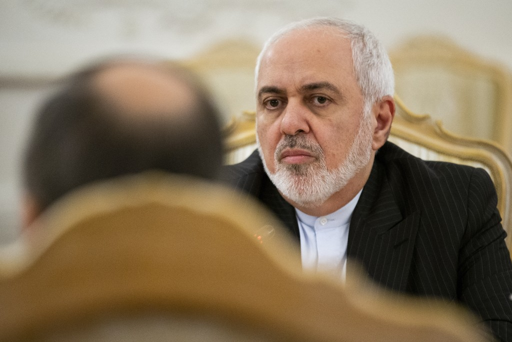 Iranian Foreign Minister Mohammad Javad Zarif listens to Russian Foreign Minister Sergey Lavrov during their talks in Moscow, Russia, Monday, Dec. 30,...