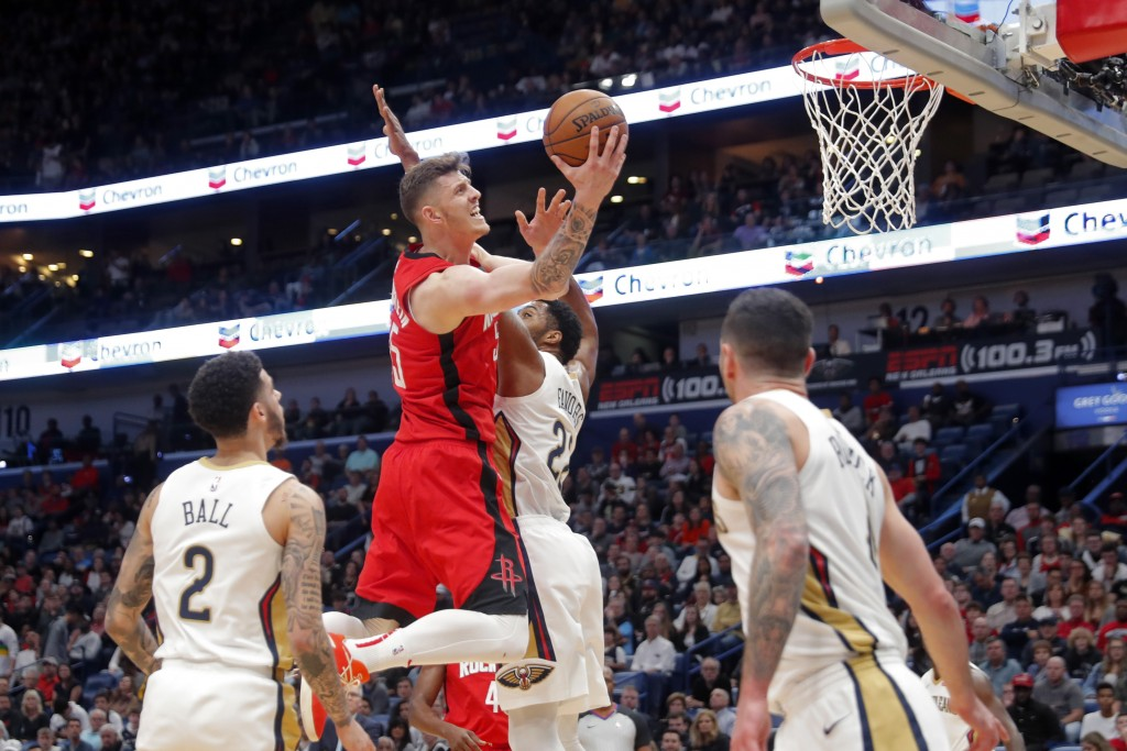 Houston Rockets center Isaiah Hartenstein (55) goes to the basket against New Orleans Pelicans forward Derrick Favors (22) in the first half of an NBA...