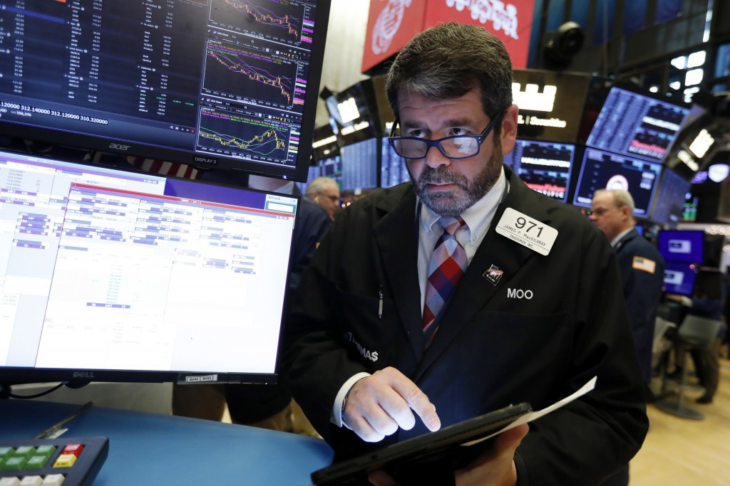 FILE - In this Dec. 5, 2019, file photo trader James MacGilvray works on the floor of the New York Stock Exchange. The U.S. stock market opens at 9:30...