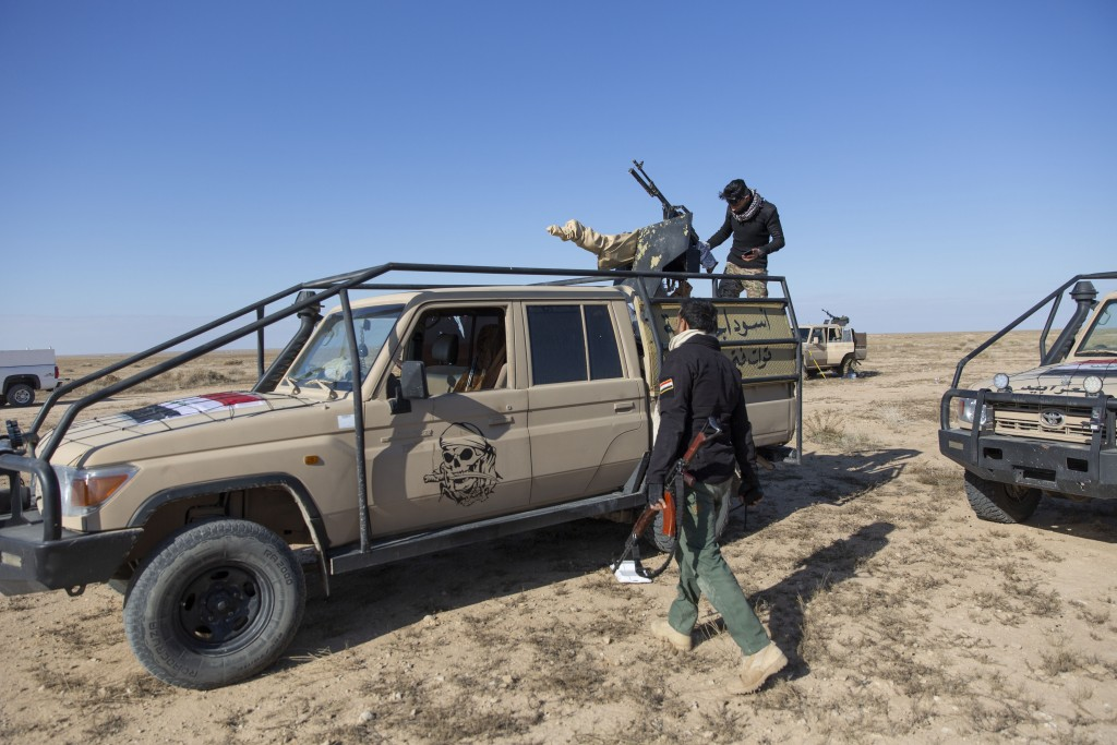Paramilitary Popular Mobilization Forces and local tribal militias participate in the military operations of the Iraqi army Seventh Brigade, at the st...