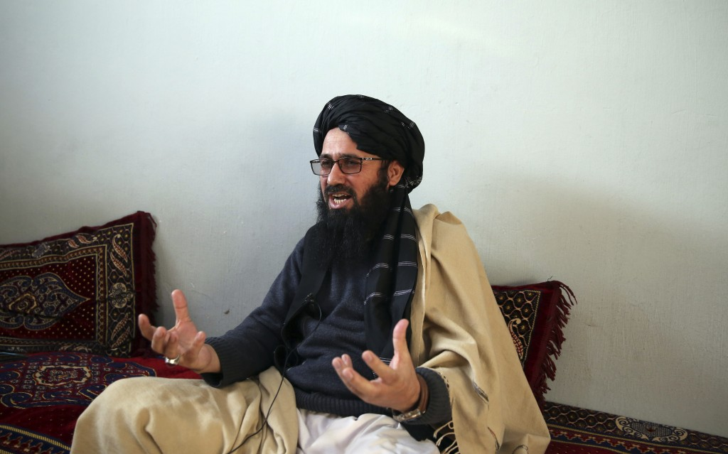 In this Saturday, Dec. 14, 2019, photo, Maulvi Niaz Mohammad, 45, speaks during an interview with The Associated Press inside the Pul-e-Charkhi jail i...