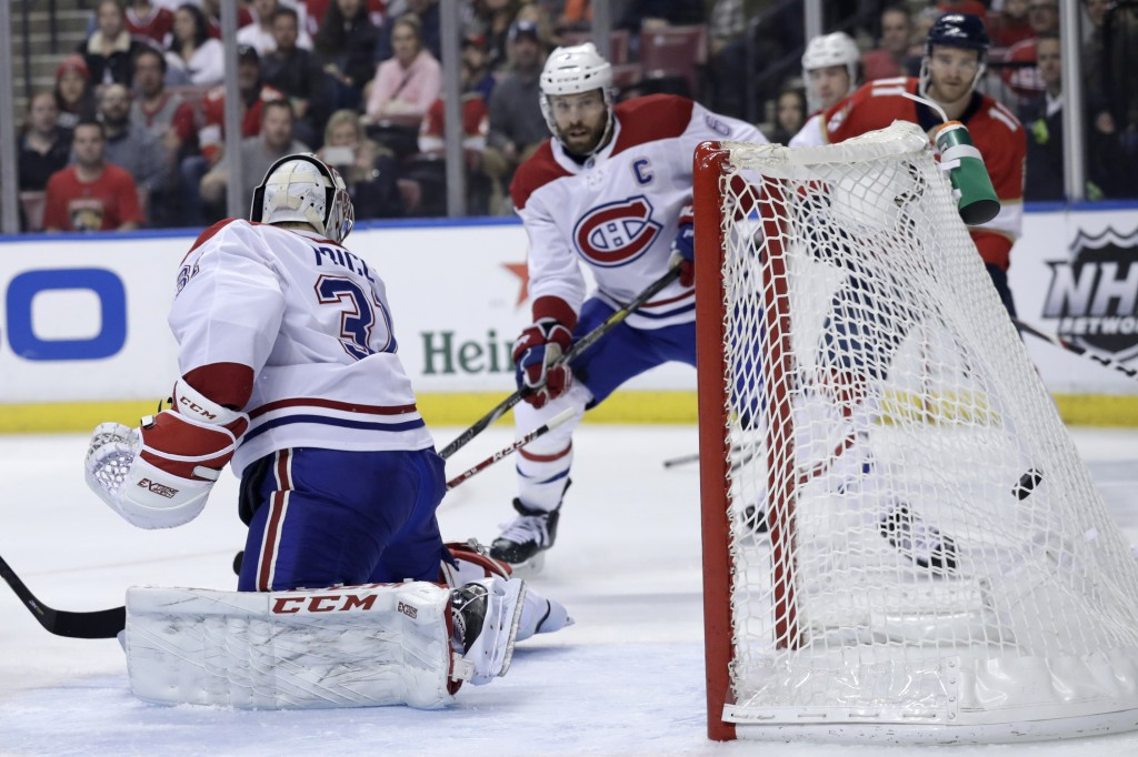 The puck gets past Montreal Canadiens goaltender Carey Price (31) for a goal scored by Florida Panthers center Aleksander Barkov during the first peri...