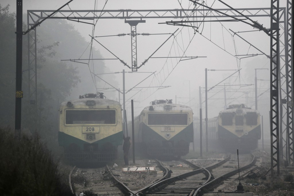 Local trains are halted amidst early morning fog in New Delhi, India, Monday, Dec. 30, 2019. The Indian capital which is witnessing the longest spell ...