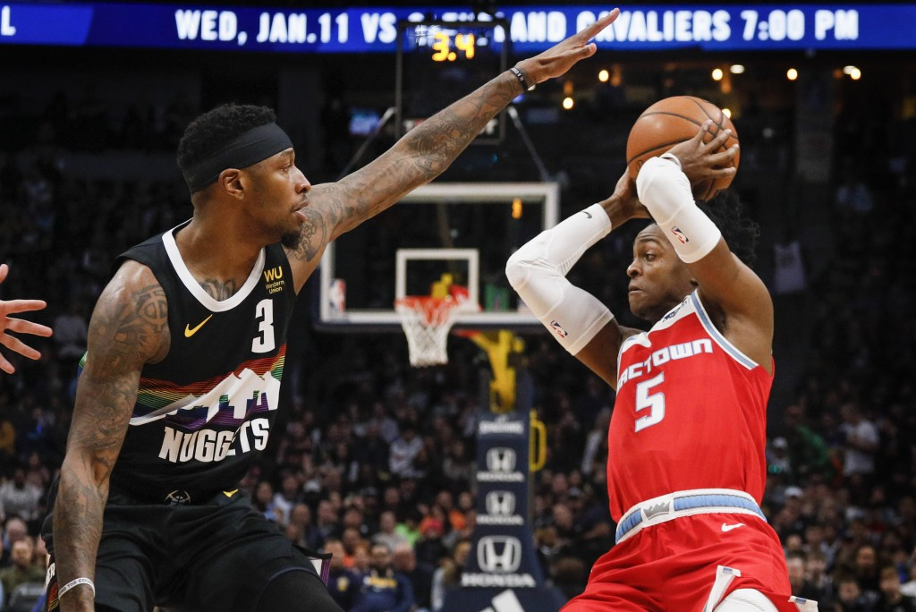 Denver Nuggets forward Torrey Craig (3) guards against Sacramento Kings guard De'Aaron Fox (5) in the first half of an NBA basketball game Sunday, Dec...