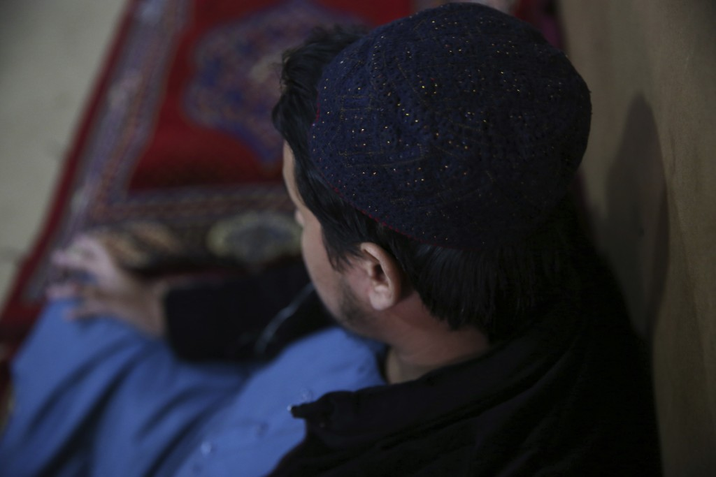 In this Saturday, Dec. 14, 2019, photo, Jailed Taliban who identified himself as Maulvi Sahab, 24, speaks during an interview with The Associated Pres...