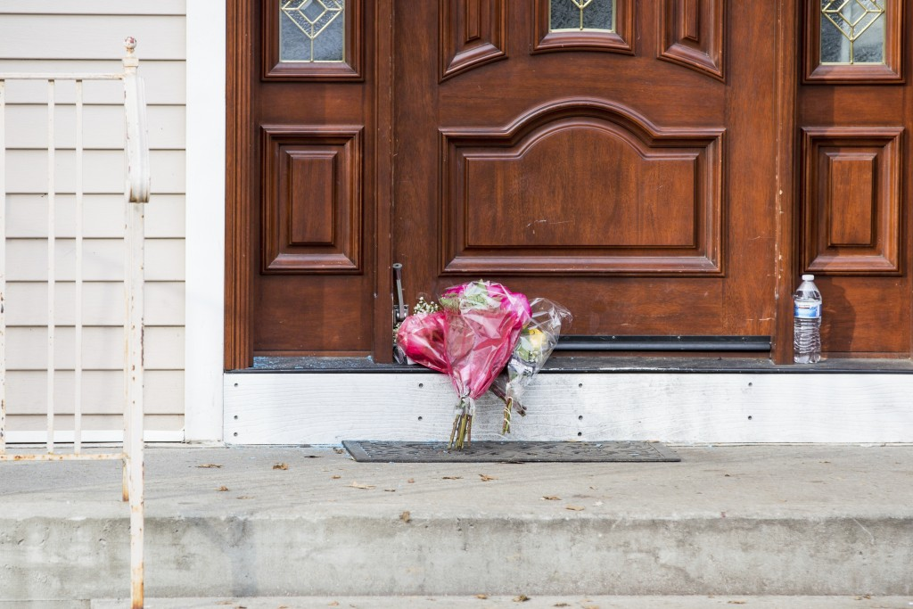 Flower bouquets rest on the doorstep of a rabbi's residence in Monsey, N.Y., Sunday, Dec. 29, 2019, following a stabbing Saturday night during a Hanuk...