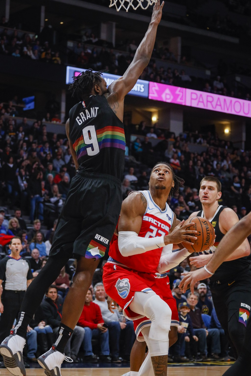 Sacramento Kings forward Richaun Holmes (22) shoots against Denver Nuggets forward Jerami Grant (9) in the first half of an NBA basketball game Sunday...