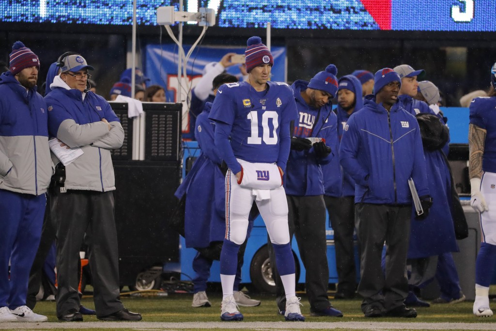 New York Giants quarterback Eli Manning (10) watches from the sidelines in the first half of an NFL football game against the Philadelphia Eagles, Sun...