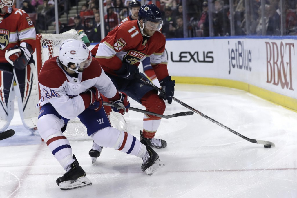 Florida Panthers left wing Jonathan Huberdeau (11) skates with the puck as Montreal Canadiens center Phillip Danault (24) defends during the second pe...