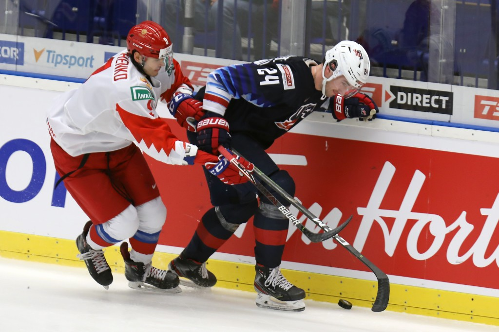From left Kirill Marchenko of Russia and Mattias Samuelsson of the United States during the 2020 IIHF World Junior Ice Hockey Championships Group B ma...