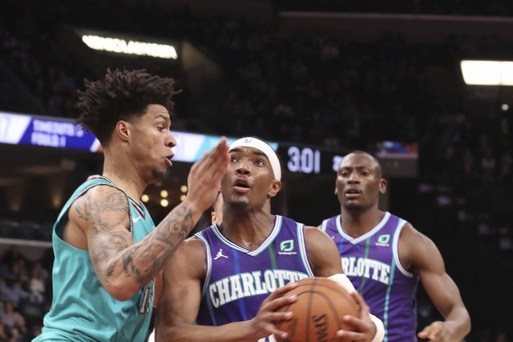 Memphis Grizzlies forward Brandon Clarke (15) Charlotte defends against Charlotte Hornets Devonte' Graham (4) in the first half of an NBA basketball g...