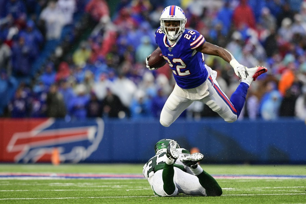 Buffalo Bills running back T.J. Yeldon (22) hurdles New York Jets strong safety Jamal Adams, bottom, during the second half of an NFL football game Su...