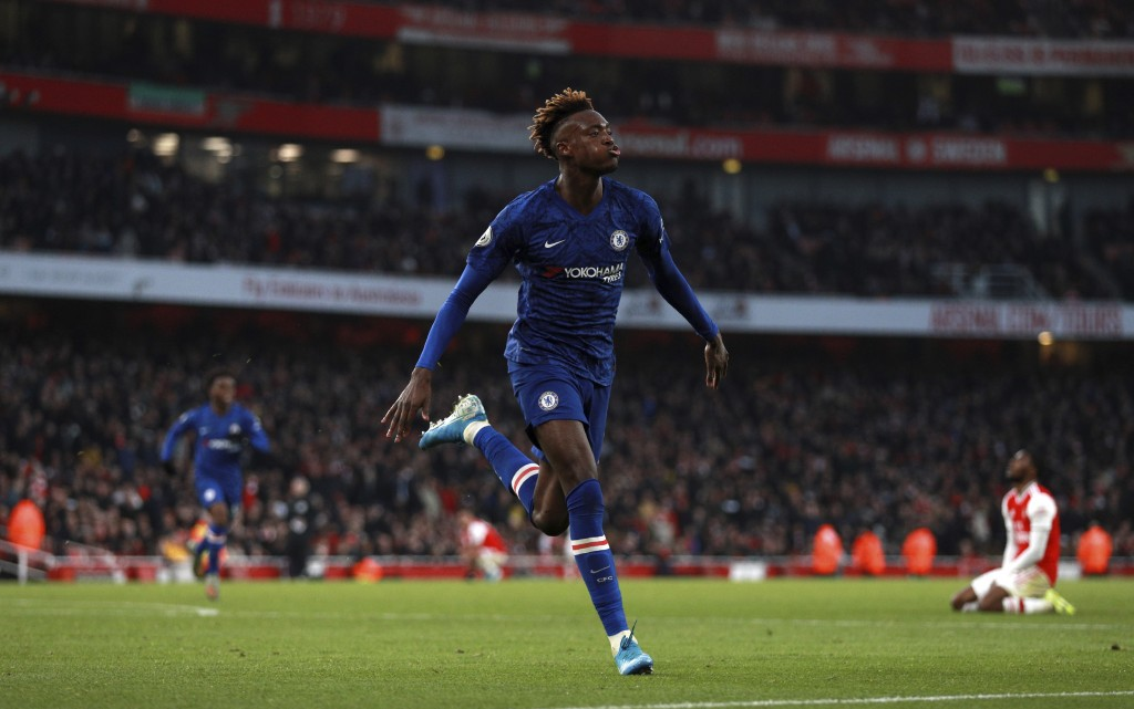 Chelsea's Tammy Abraham celebrates after scoring his side's second goal during the English Premier League soccer match between Arsenal and Chelsea, at...