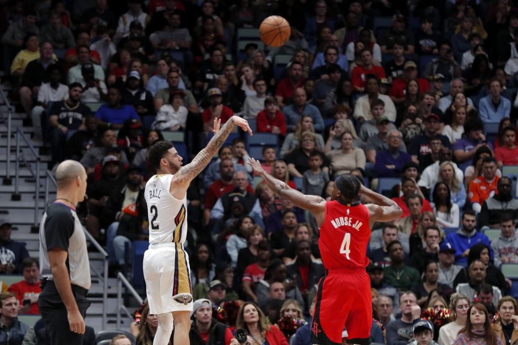 New Orleans Pelicans guard Lonzo Ball (2) shoots a three-point basket against Houston Rockets forward Danuel House Jr. (4) in the first half of an NBA...