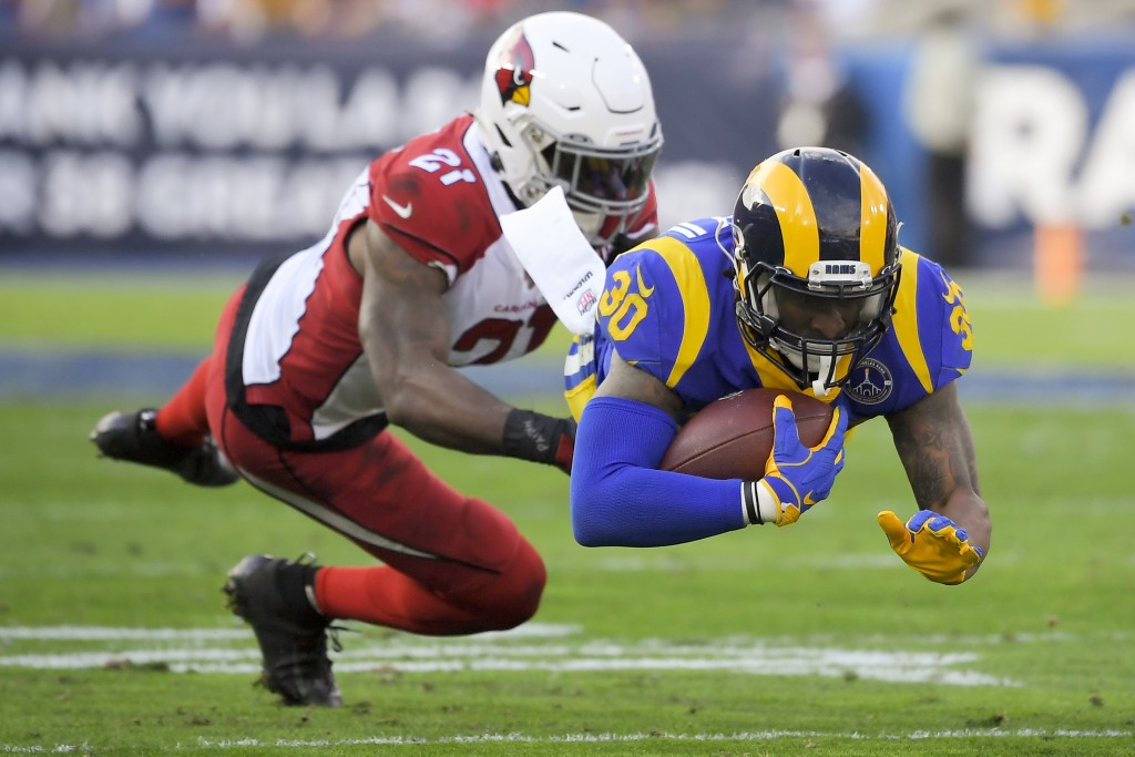 Los Angeles Rams running back Todd Gurley, right, is tackled by Arizona Cardinals cornerback Patrick Peterson during first half of an NFL football gam...